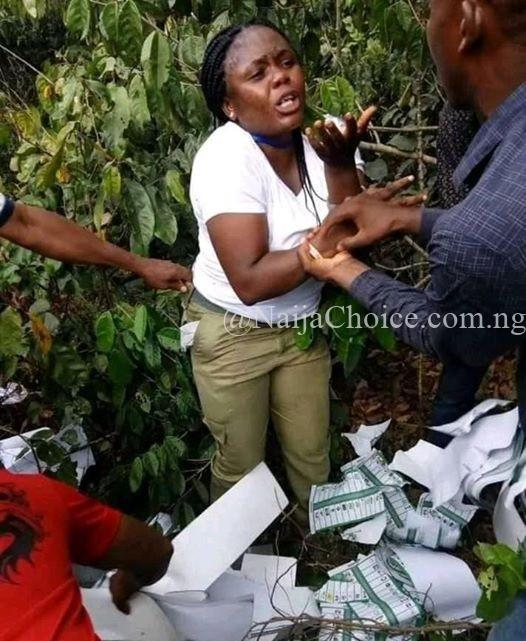Female Corper Caught In The Bush Destroying Ballot Papers In Imo (Photos)